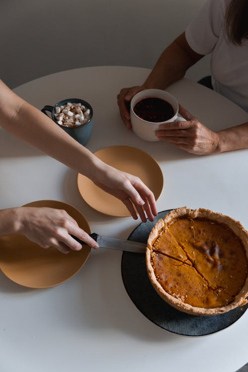 Cutting a Piece of Pumpkin Pie