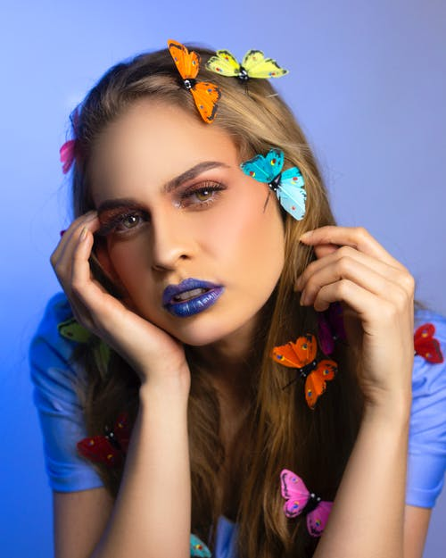 Bright dreamy woman with colorful butterflies