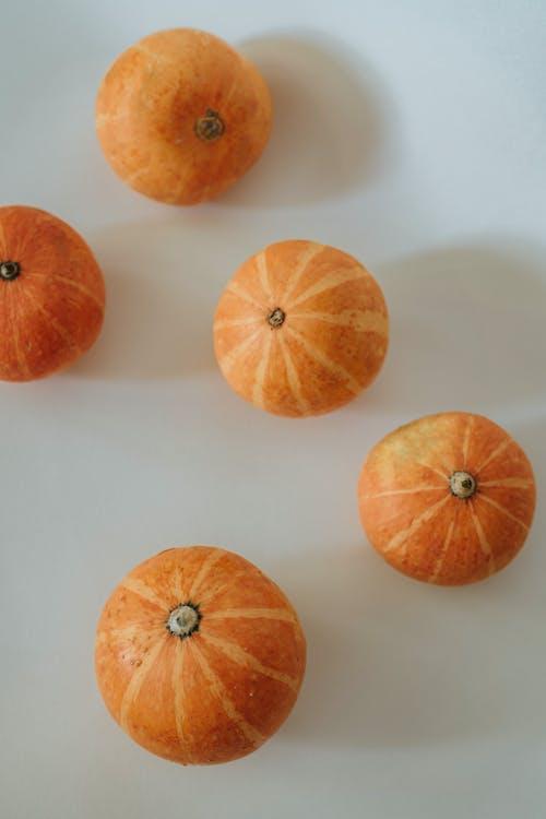 Orange Fruit on White Table