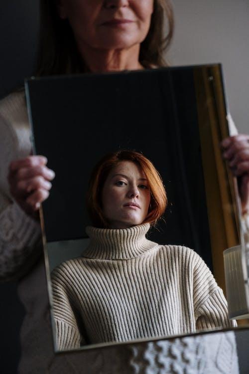 Woman in White Turtleneck Sweater