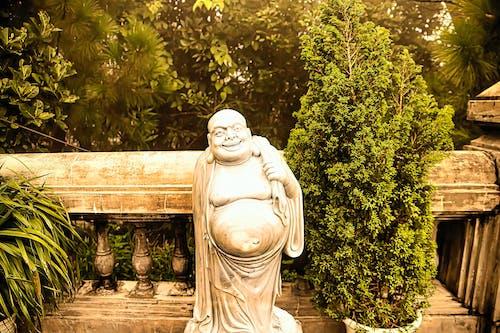 White Concrete Statue Near Green Trees
