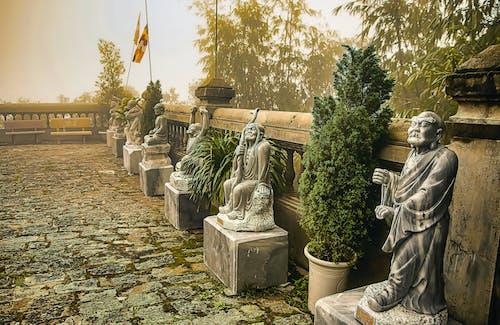 Stone Statues of Men Near the Concrete Railings