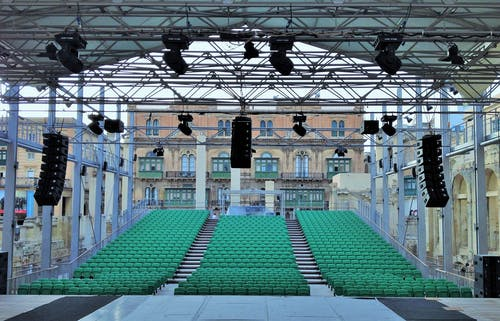 Outdoor auditorium and stage with professional equipment on city square