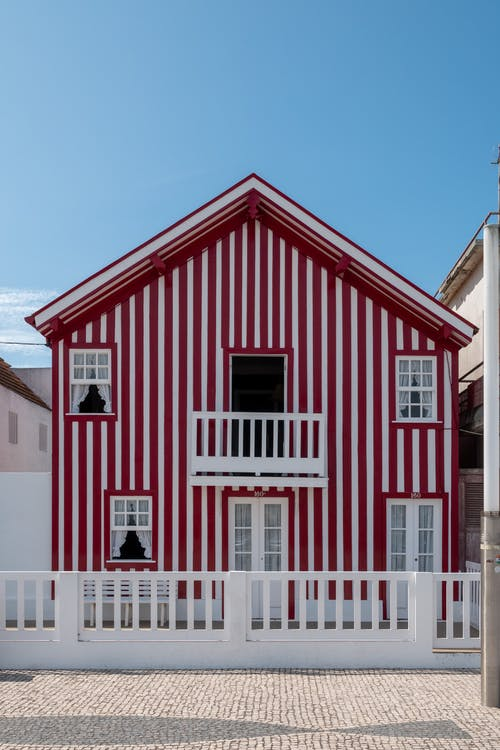 Red and White Wooden House Under Blue Sky