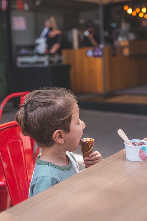 Girl in Teal Shirt Eating Ice Cream