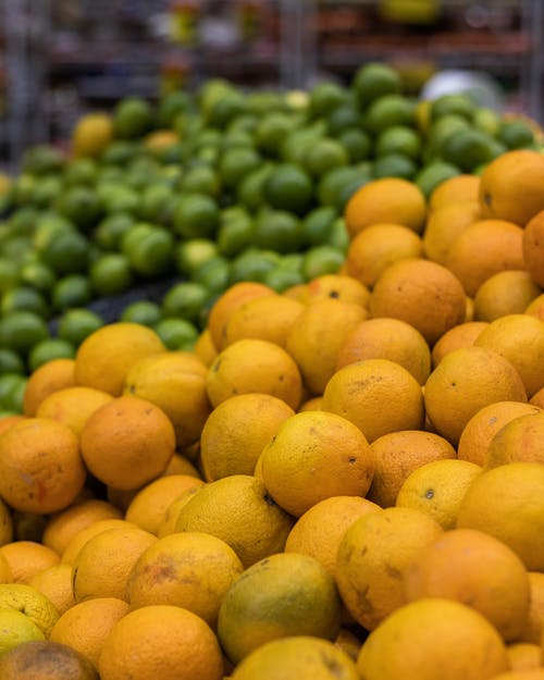 Yellow Citrus Fruits on Display