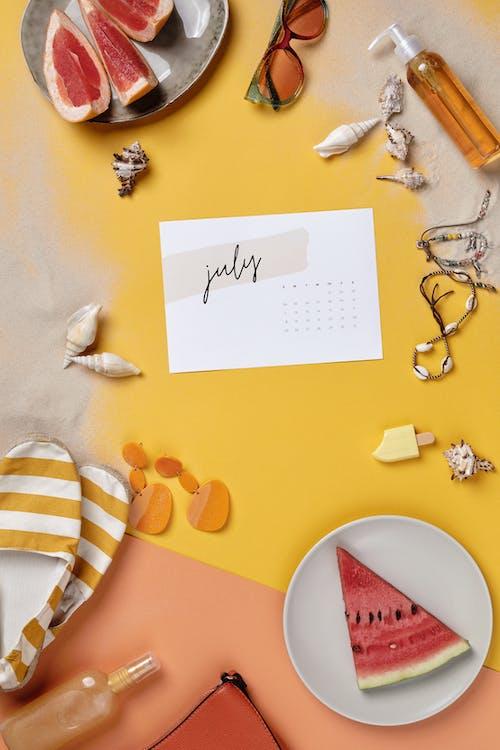 White Printer Paper on Yellow and White Polka Dot Textile