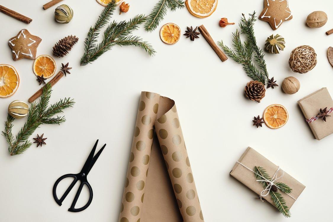 Black Scissors Beside Brown and White Gift Box