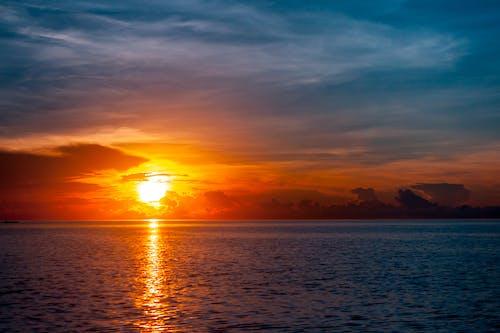 在海邊, 平静的海面, 海, 海滩日落 的 免费素材图片