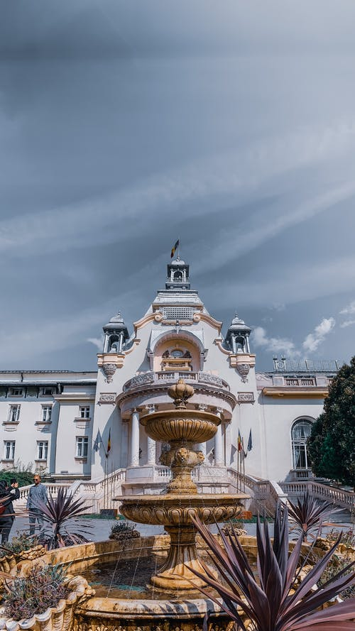 Grand white palace with majestic fountain