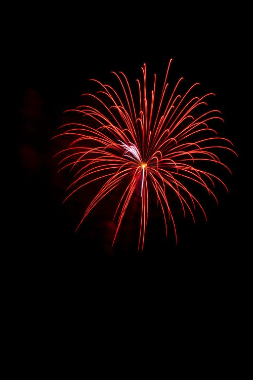 Red Fireworks in the Sky during Nighttime