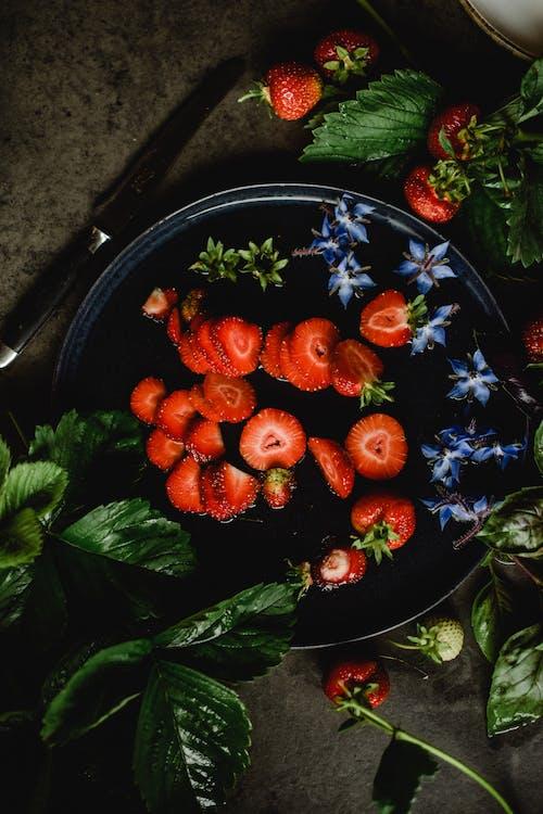 Strawberries on Blue Ceramic Plate