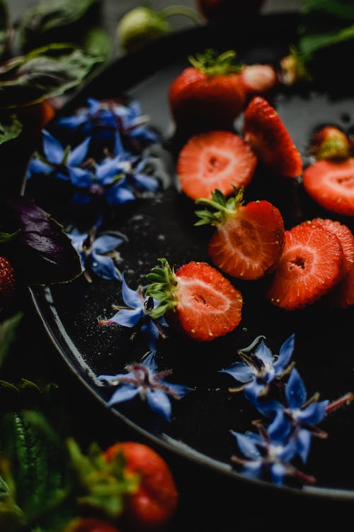 Sliced Strawberries on Blue and White Floral Ceramic Plate