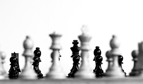 A Grayscale Photo of Chess Pieces