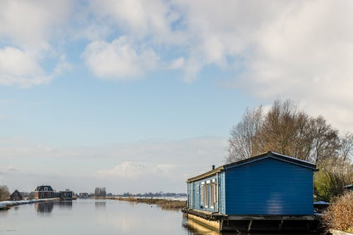 Blue Wooden House on the Lake