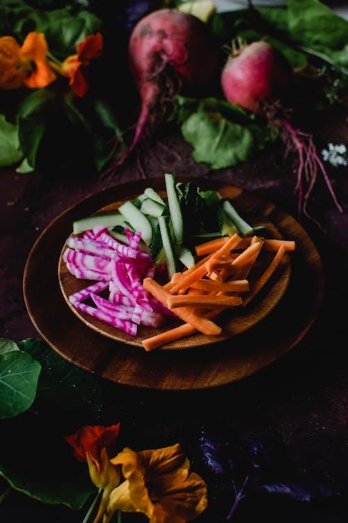 Sliced Vegetables on Brown Wooden Plate