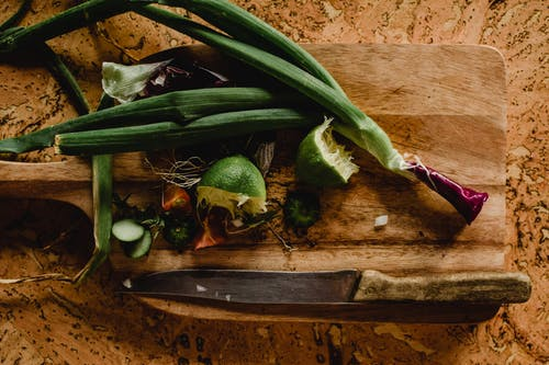 Sliced Lime and Onion Leeks on Wooden Chopping Board