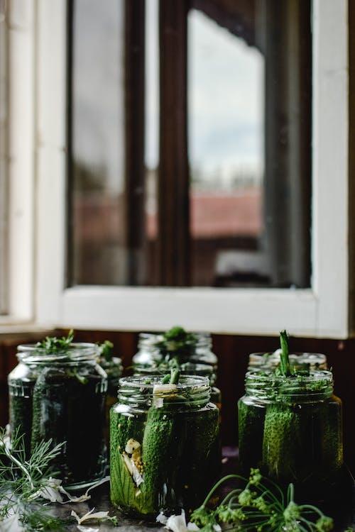 Cucumbers Preserved in Glass Jars