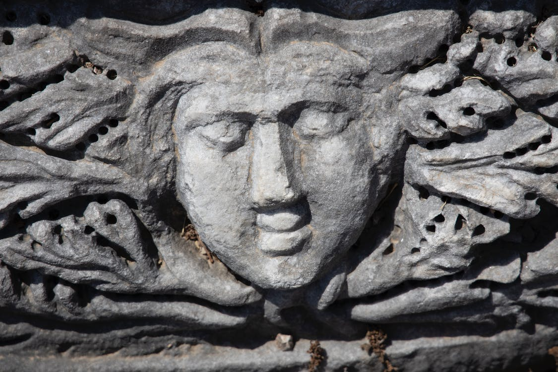 Gray Concrete Human Face Carved Decor