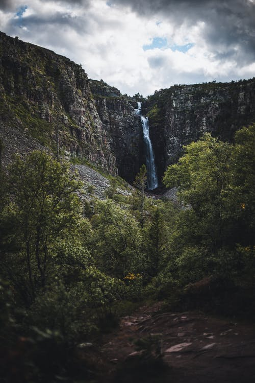 Waterfalls on Rocky Mountain with Green Trees