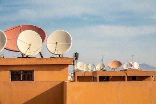 White Satellite Dish on Orange Roof