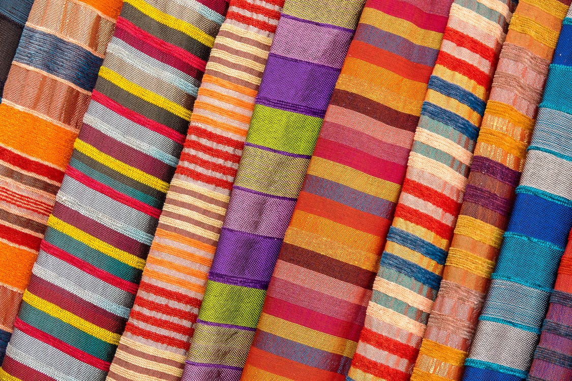 Purple Yellow and Pink Striped Textile