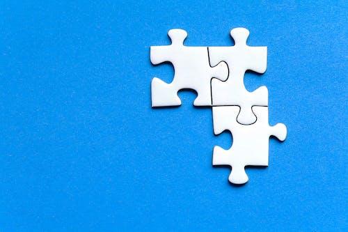 Puzzle Pieces on Blue Surface