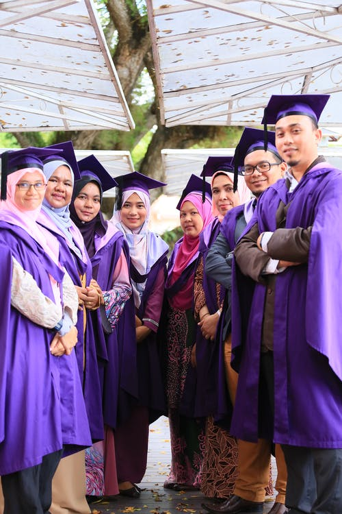 Group of People Wearing Academic Dress