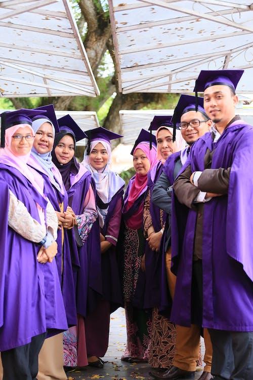 Group of People Wearing Academic Dress