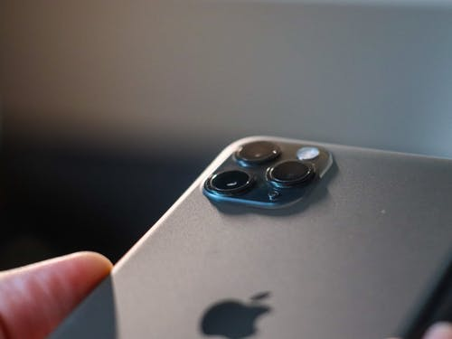 Person Holding Silver Iphone 5 S