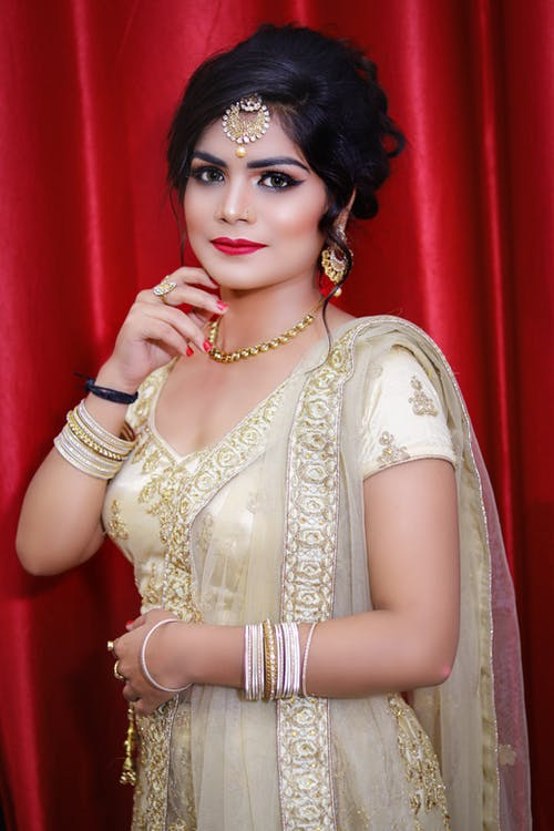 Elegant Indian lady wearing traditional bridal clothes with jewelries