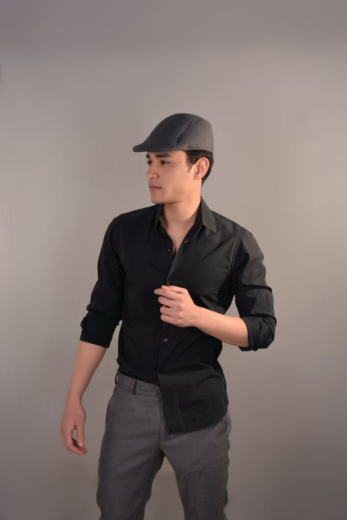 Man in Black Button Up Shirt and Black Cap
