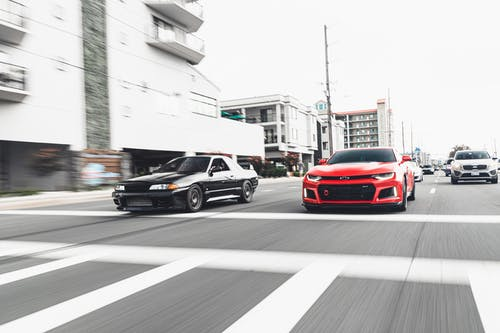 Black and Red Cars on Road