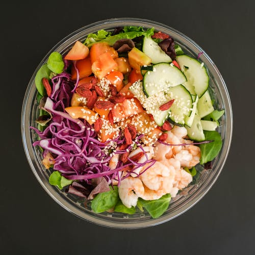 Mix of healthy fresh vegetables and shrimps in bowl