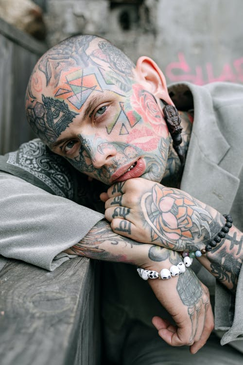 Person With Tattoo on Left Hand