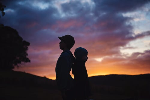 Silhouette Photography of Two Children's