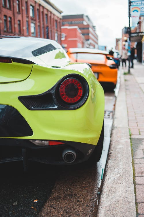 Modern sports cars parked on street