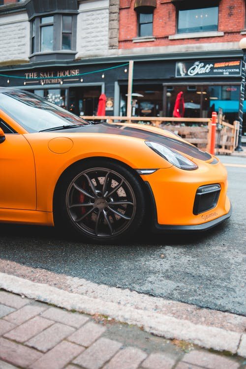 Luxury modern sports car driving on street