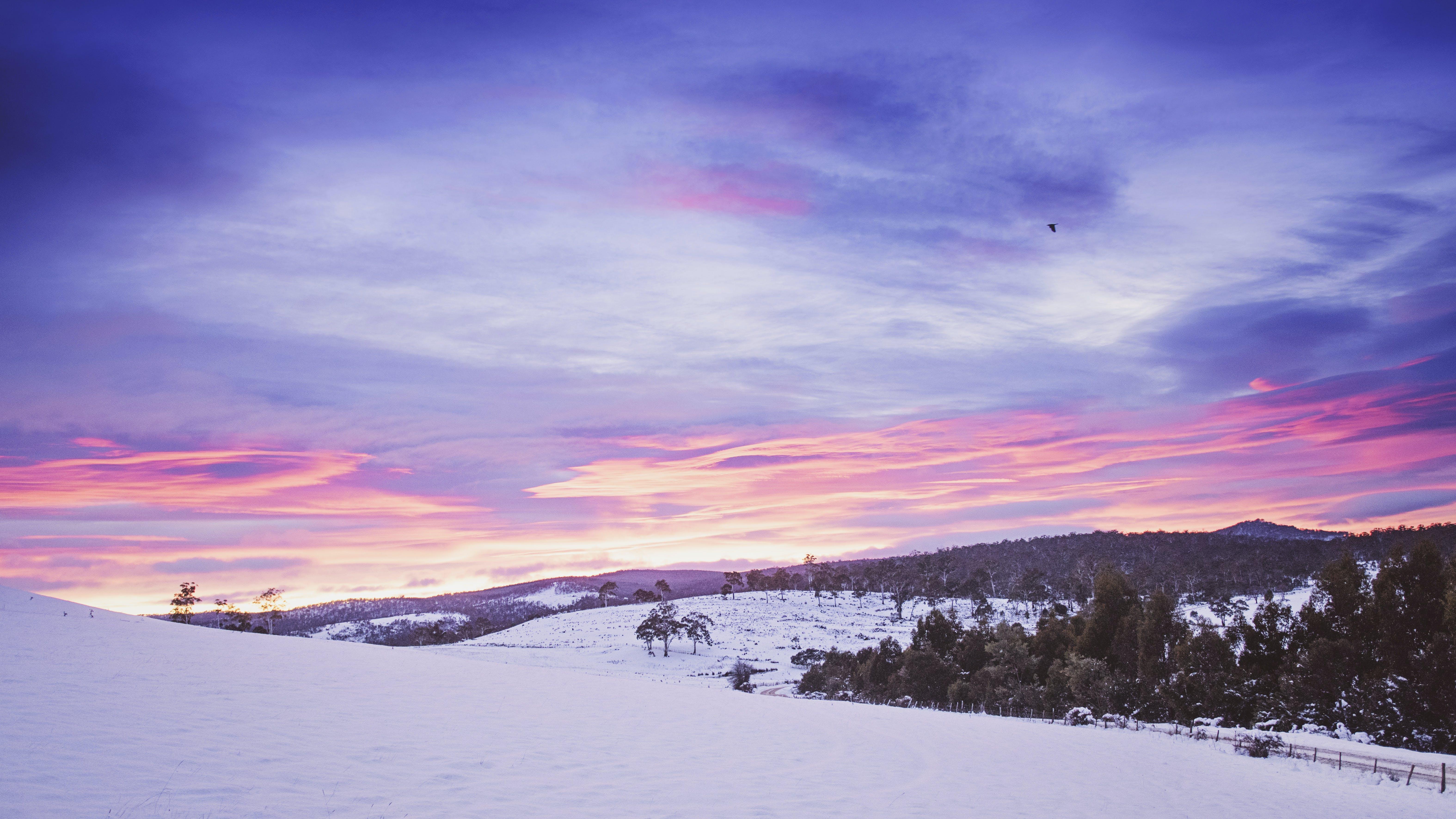 Orange Sunset and Snow Field