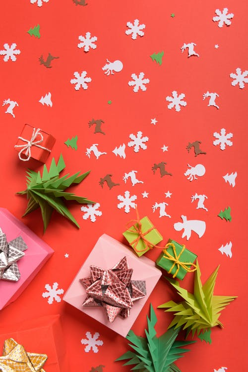 Colorful paper cutouts in Christmas composition