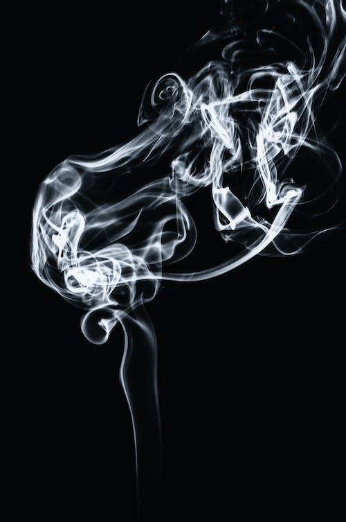 Abstract backdrop of wavy smoke on black background