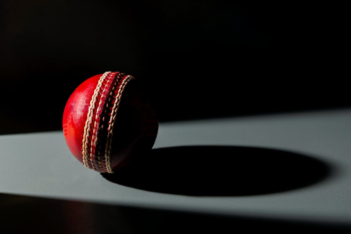 Red and Black Ball on White Surface