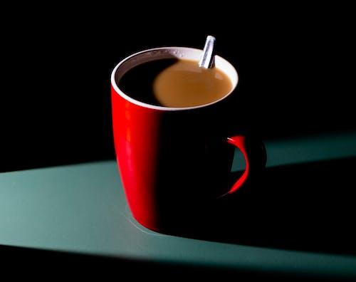 Red Ceramic Mug With Coffee