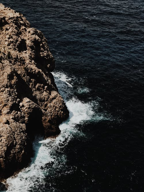 Rocky cliff near splashing sea