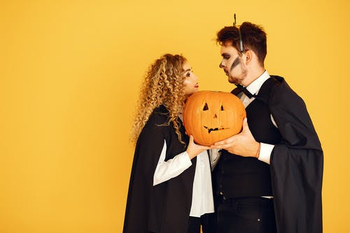 Couple in Halloween Costumes Looking at Each Other