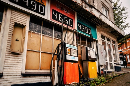 Free stock photo of city, gas pump, gas station, old building