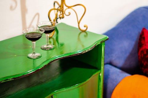 Glasses of wine on cupboard