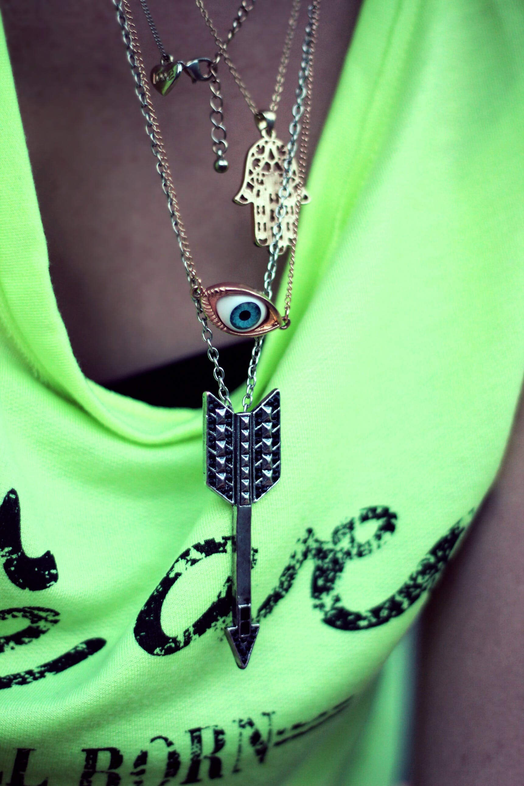 Pendants: eye, arrow, hamsa