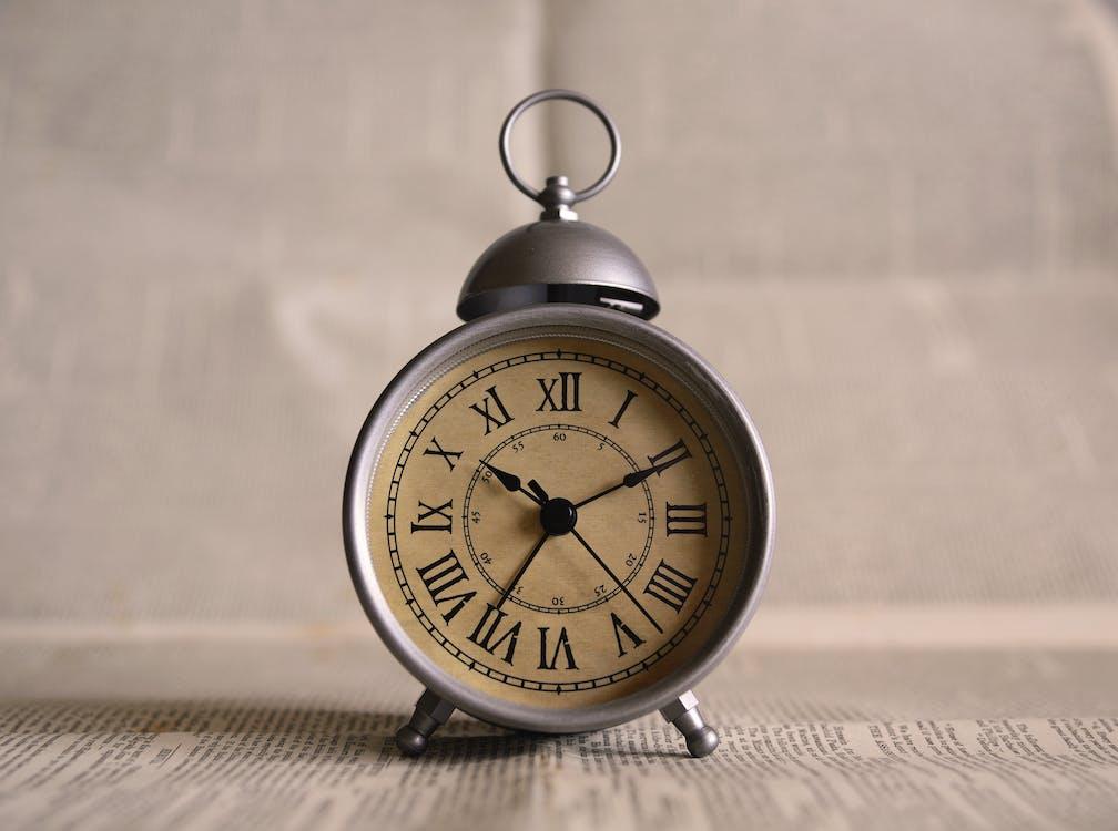 Gray Analog Clock Displaying at 10:36