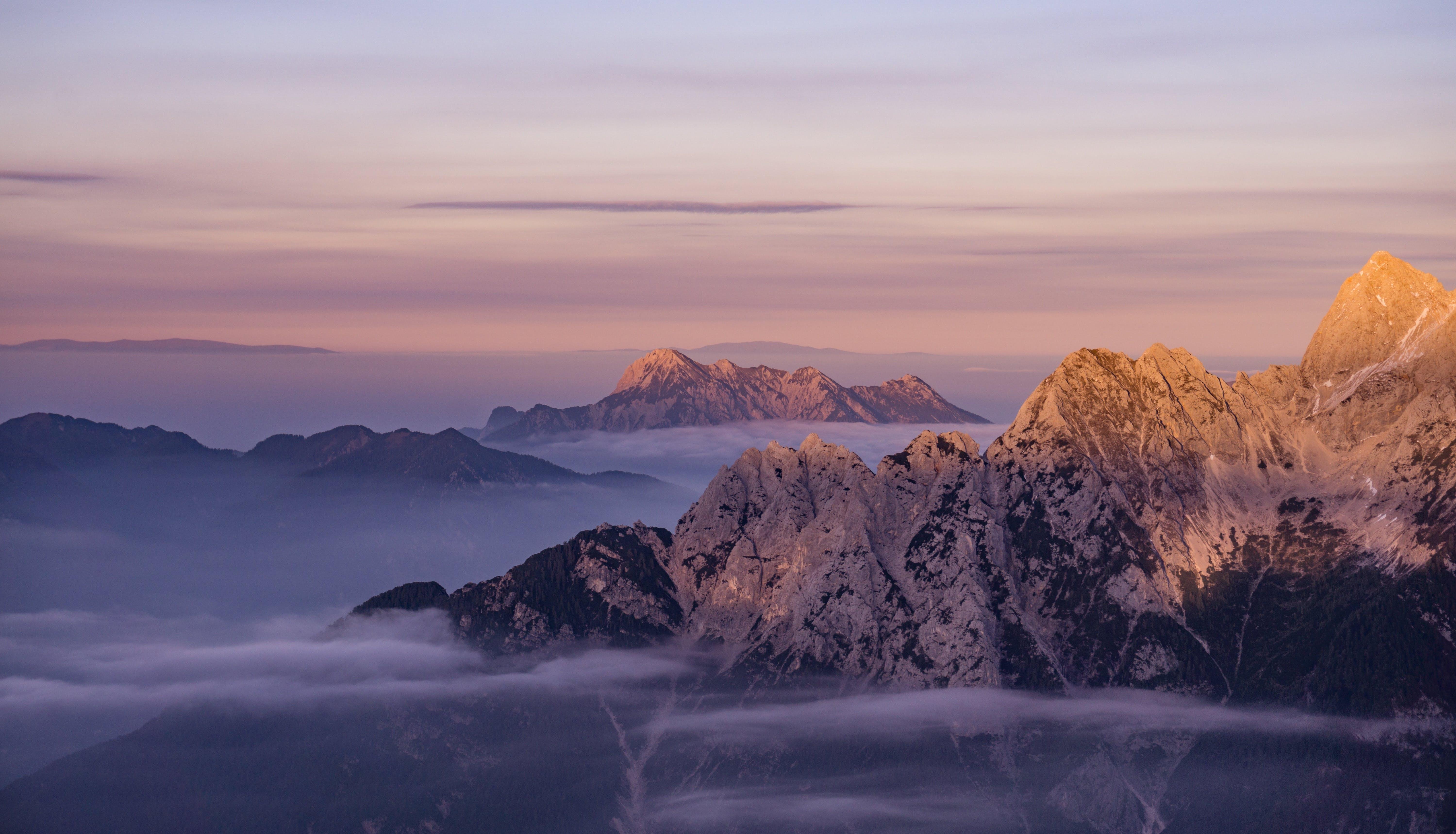 Mountain Ranges Under Orange Sunset